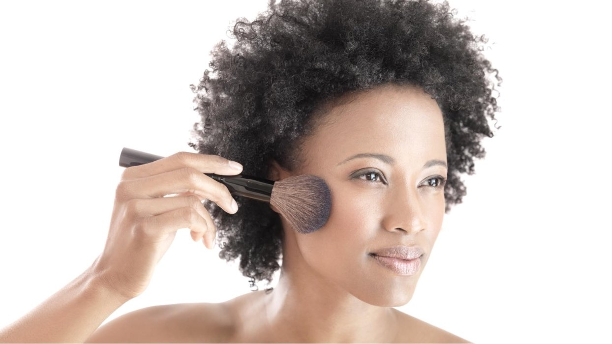 Woman with facial brush beauty shot