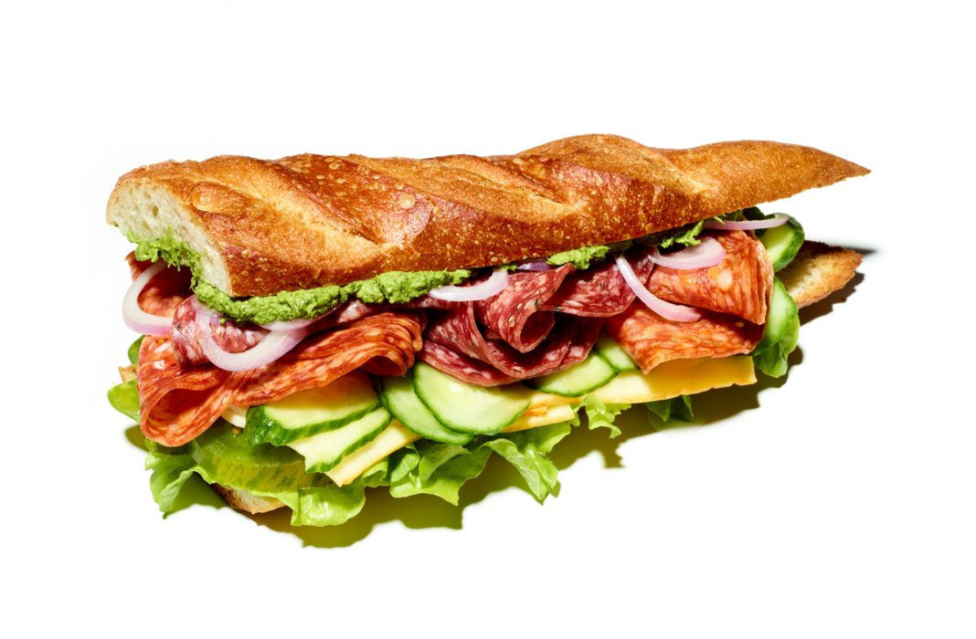 A deliciously bold sandwich on white with modern light