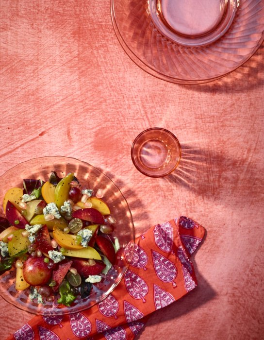 A fruit salad in a top down shot on with lots of pink