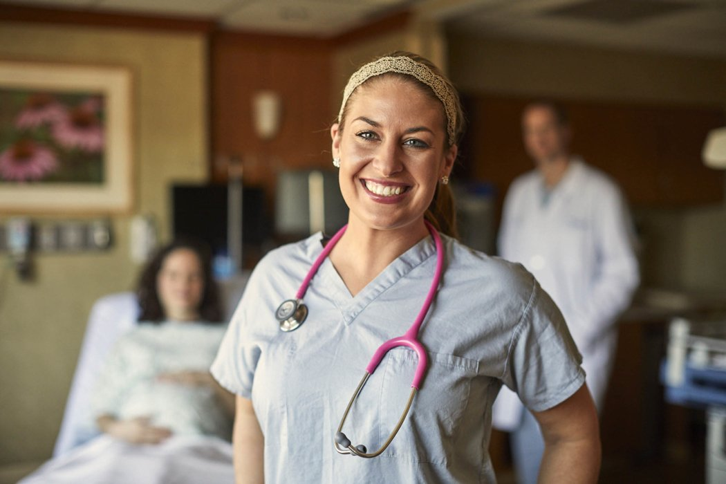 Happy nurse healthcare worker in maternity ward | Healthcare Photographer