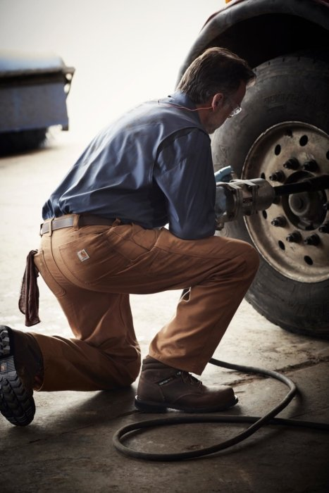Man working in Carhartt clothes working on a truck