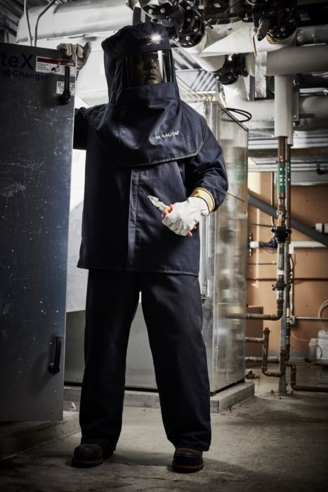 A worker wearing protective gear in an industrial environment - industrial workplace photography