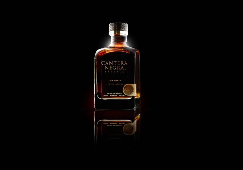 Prestine bottle of cantera negra tequila - drink photography
