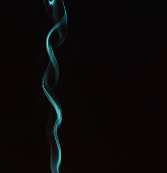 Image of swirling smoke on black background alternate photo retouching