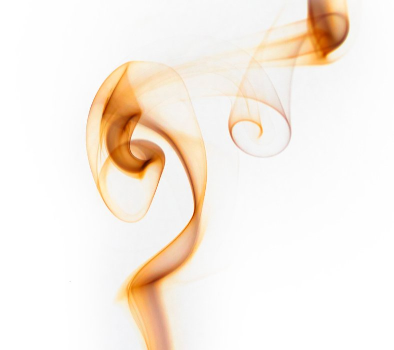 Image of swirling smoke on white background