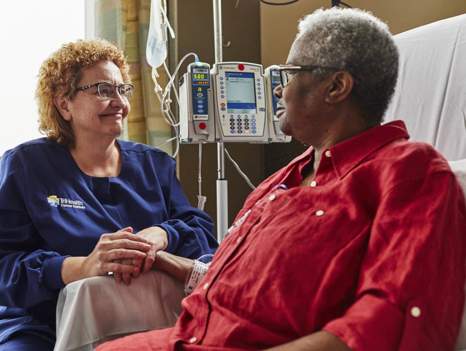 Healthcare worker talking o a patient| Healthcare Photographer