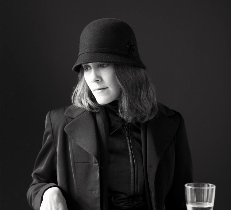 Portrait of a woman in black and white wearing a vintage hat