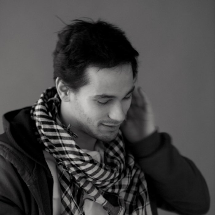 Portrait of a man with a scarf black and white