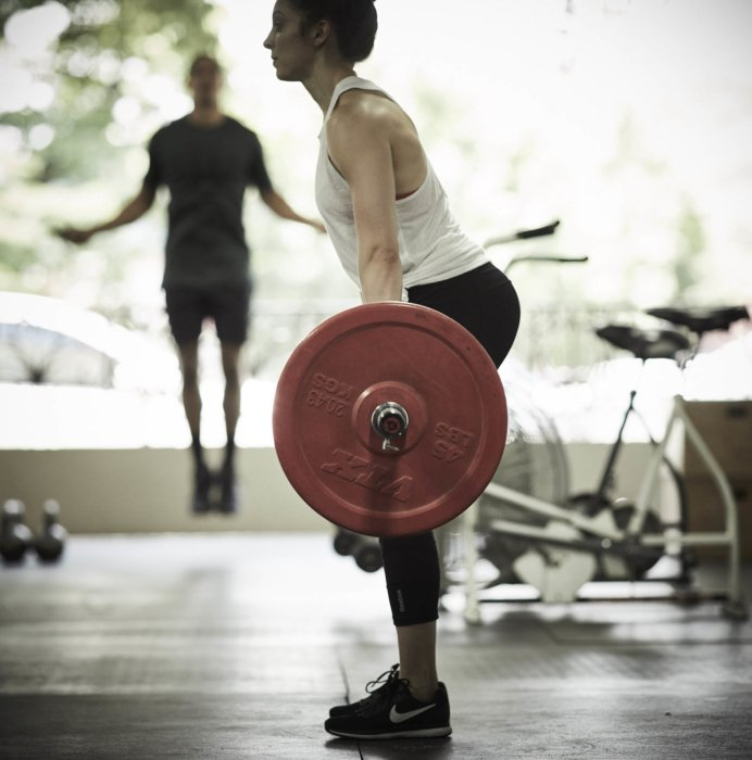An athlete dead lift weights