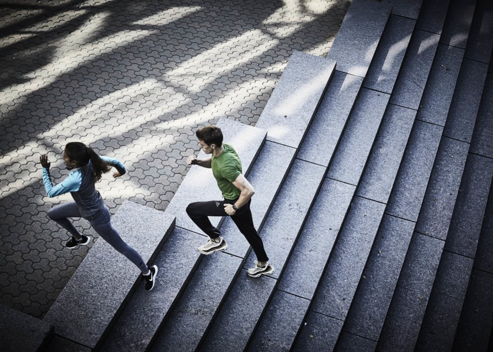 Two runners training on a set of steps