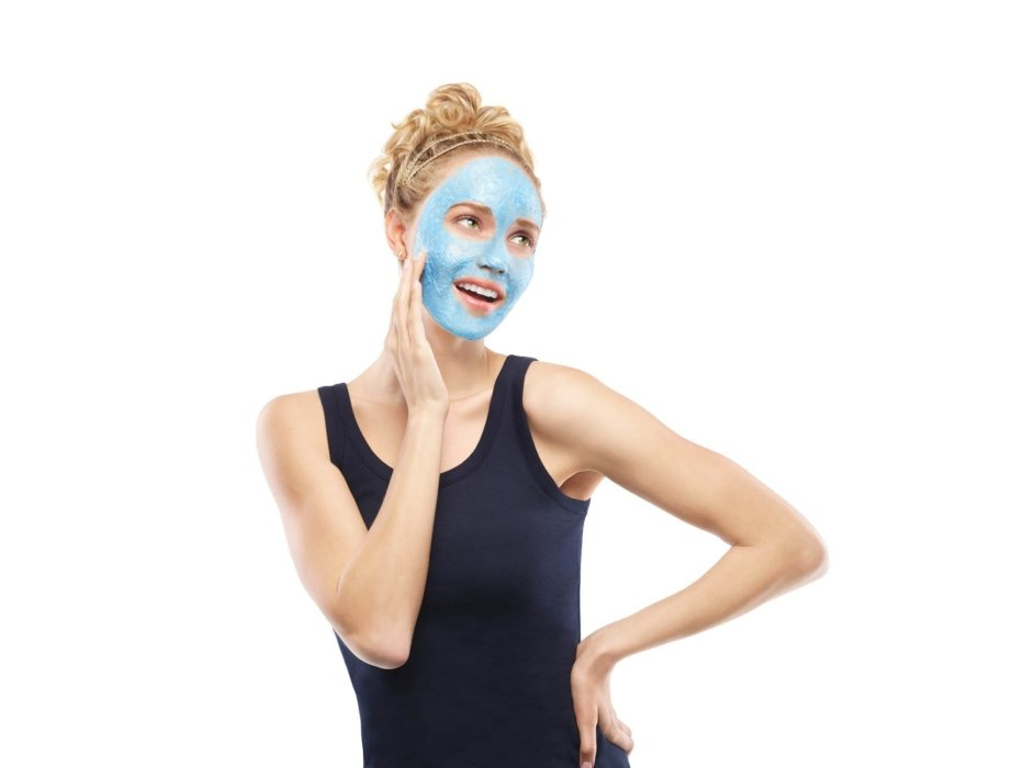A young model demonstrating a blue facial mask