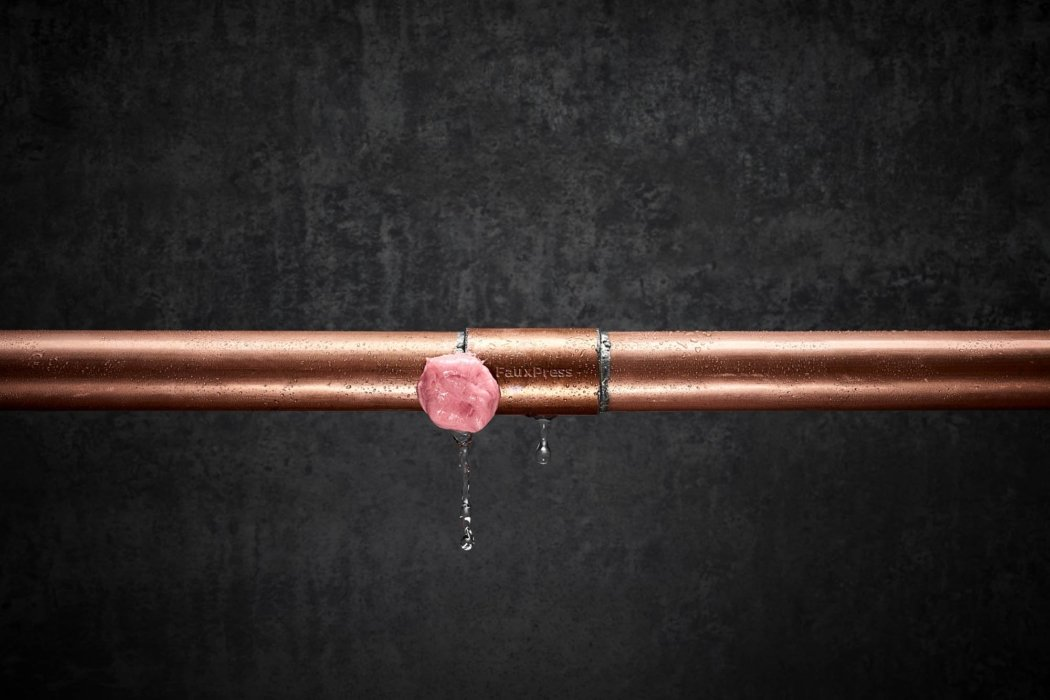 Liquid photography - a leaky copper pipe being sealed with gum