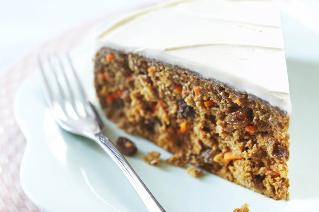Food photography - perfect Carrot Cake on a blue plate