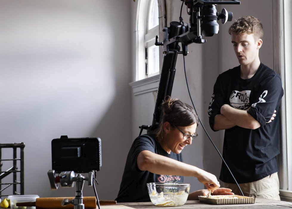 Jen and Jake prepping food on a video shoot