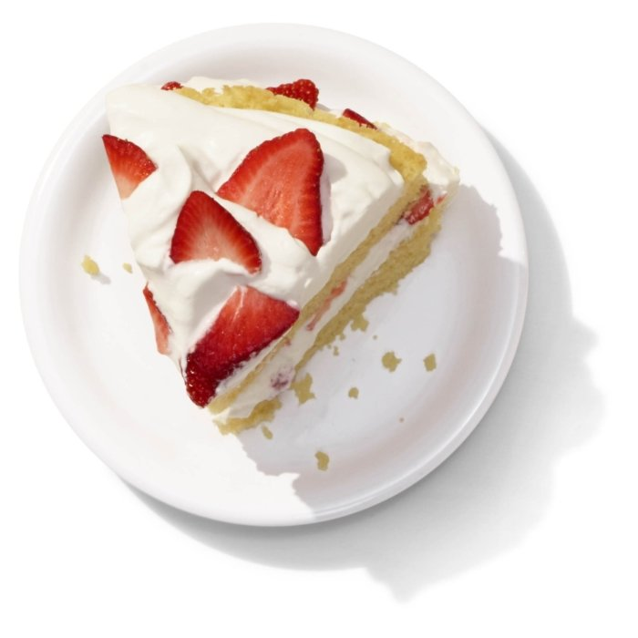 A tasty slice of strawberry pie and whip cream cake on white