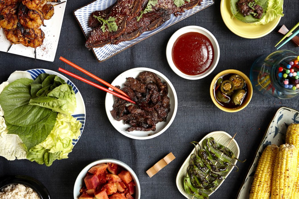 A beautiful top down, flat lay, of bbq foods, asian foods and more