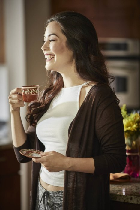 Lifestyle of a woman enjoying coffee in PJs