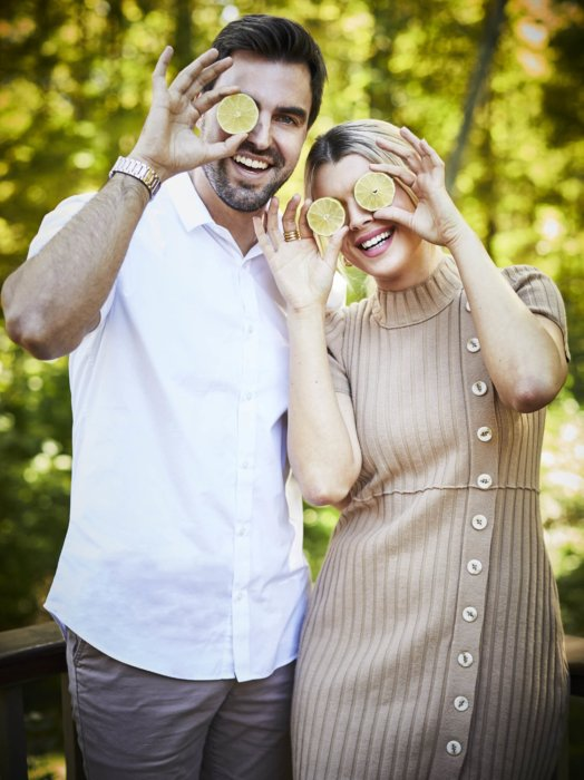Lifestyle of couple playing with sliced limes