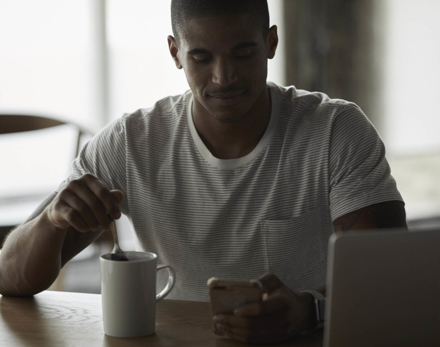 Lifestyle of a man sitting down for a cup of coffee in the morning