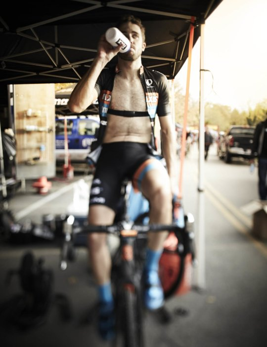 Cyclocross rider backstage drinking water