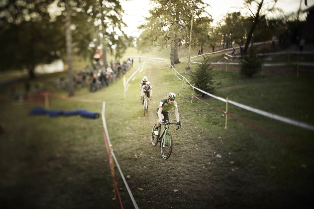 Two cyclocross riders coming down a grass track