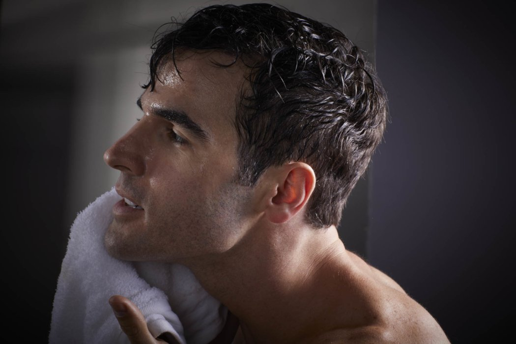 Beauty shot of a man with towel after shaving