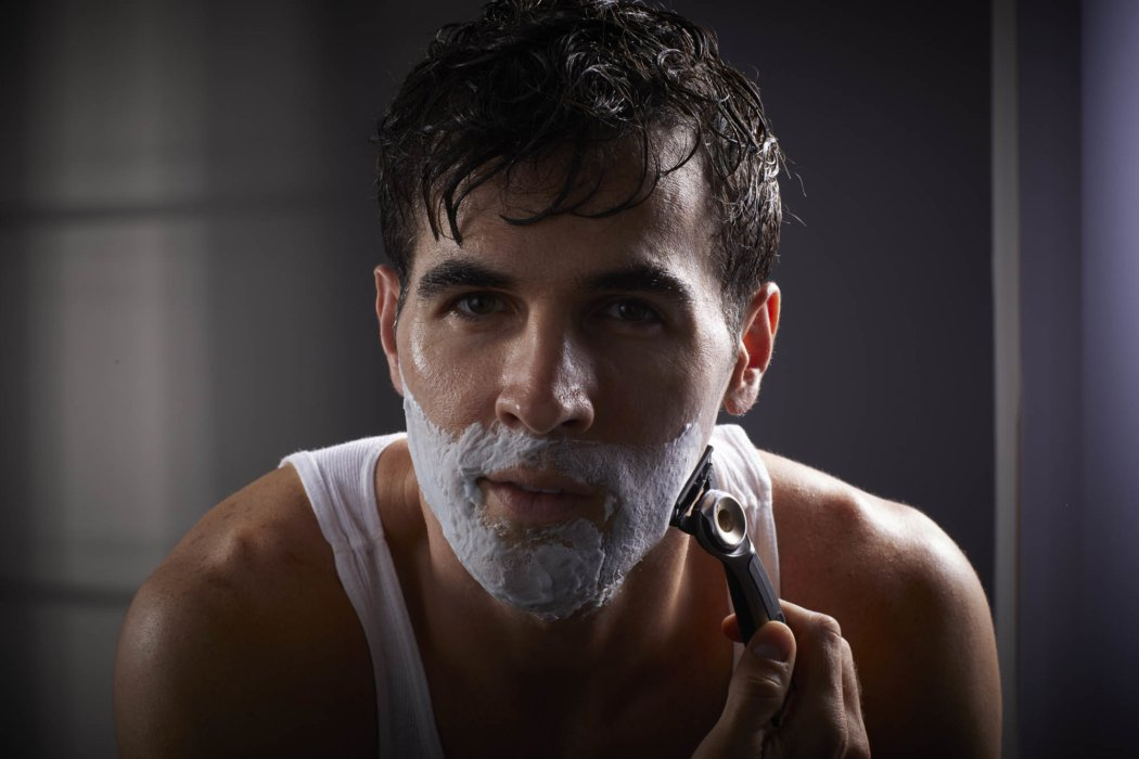 Beauty shot of a man shaving