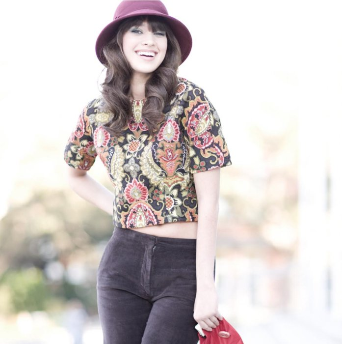 A happy fashion model wearing 60s clothing