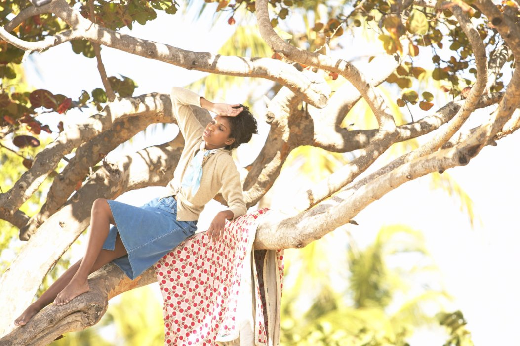 Fashion photo of a woman up in a tree