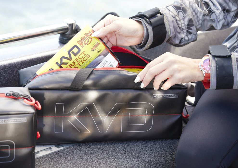 A woman using KVD brand tackle boxes