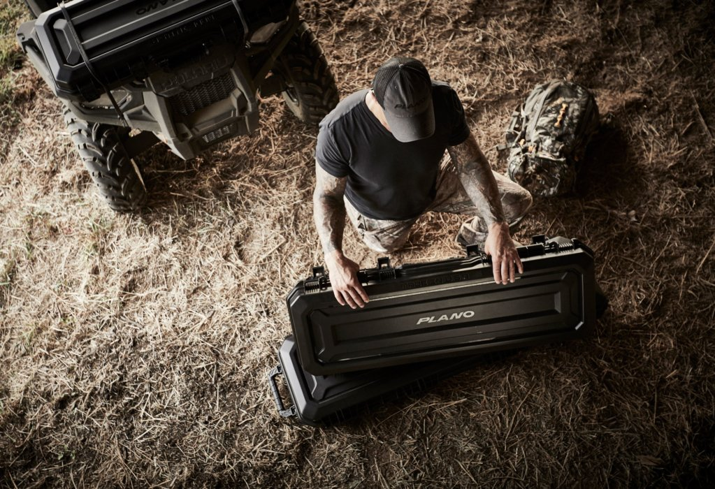 A hunter with plano gun case getting ready for a hunt