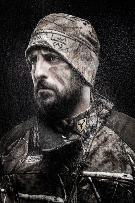 Portrait of a bearded hunter in full sent shield gear
