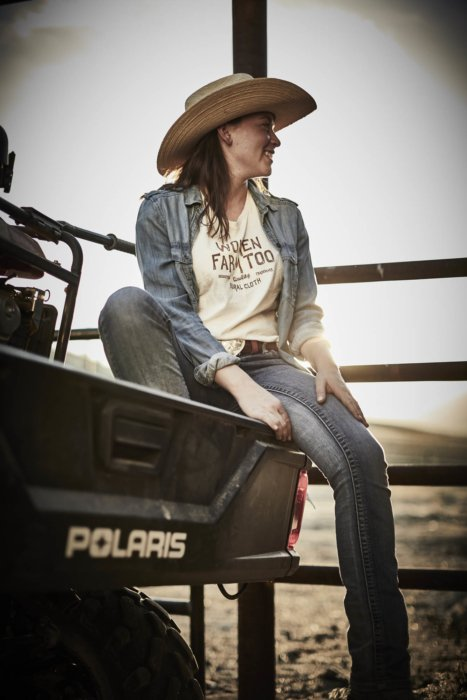 A female rancher taking a break on a polaris atv