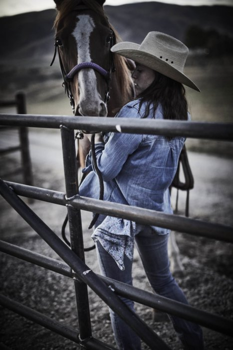 A female rancher working on horses