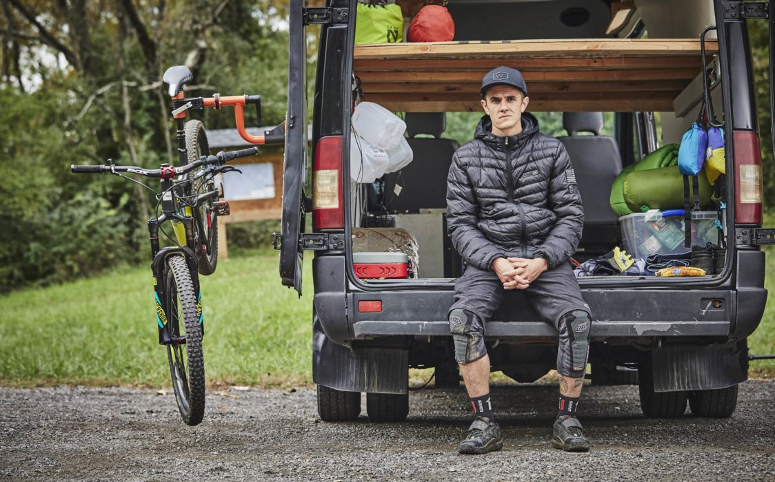 Cyclist Trevor Gay sitting at his van