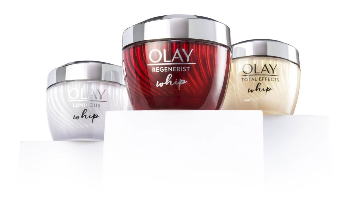 Some olay products on white