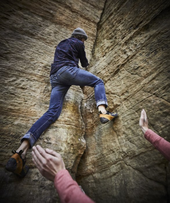 A man free climbing up a rock face