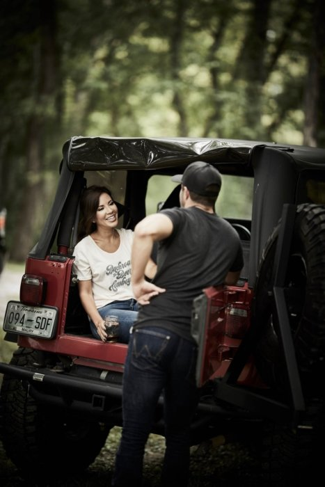 A man and woman chatting in the back of jeep