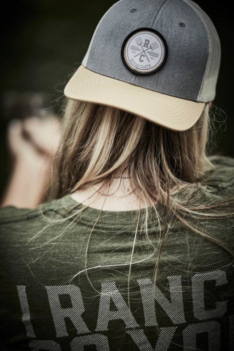 The back of a woman wearing rural cloth apparel and hat