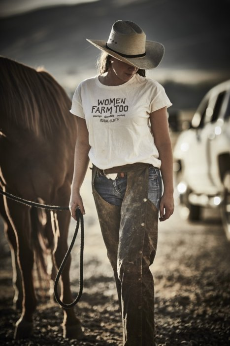 A woman rancher wearing rural cloth apparel