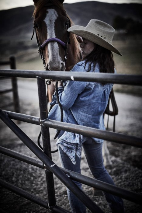 A woman wearing rural cloth clothes with a horse - apparel photography
