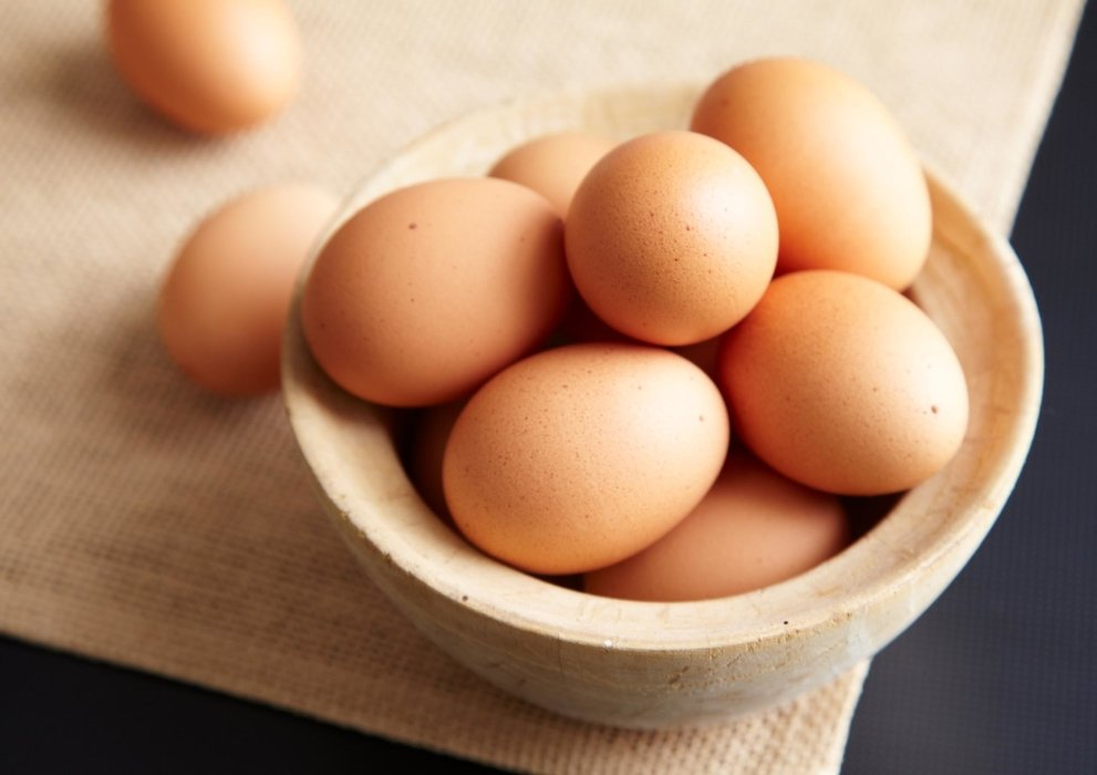 Fresh raw brown eggs in a bowl