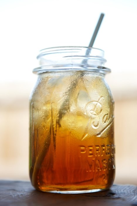 Iced tea in a mason jar with a straw