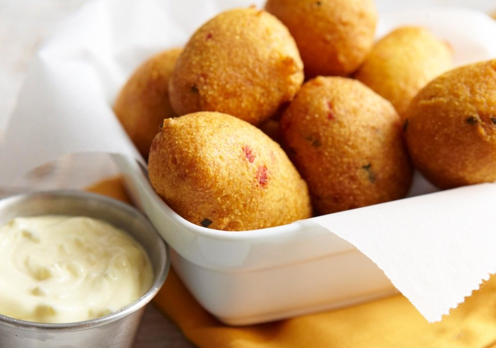 A side of hush puppies with sauce