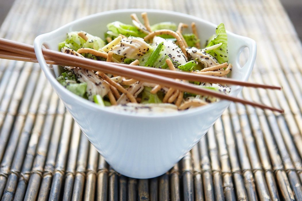 Bowl of salad with chopsticks