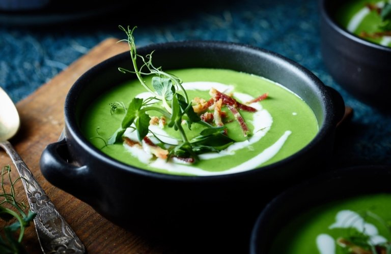A green soup with sour cream