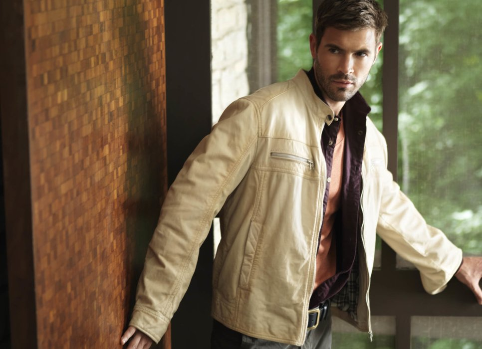 Male apparel model wearing a tan jacket