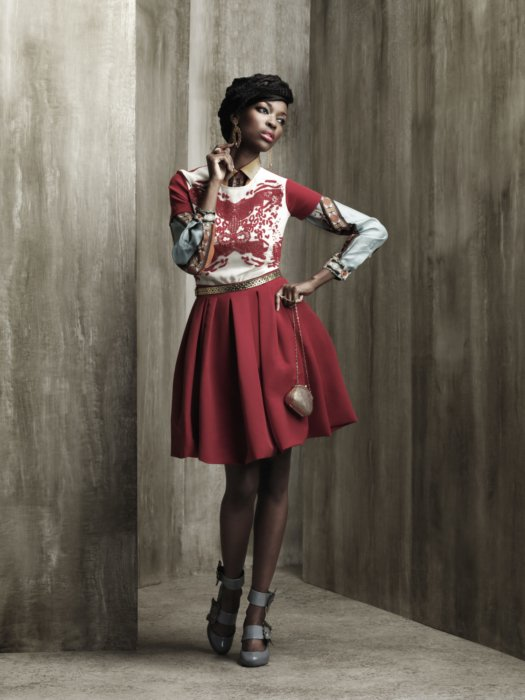 Female fashion model wearing red and white dress apparel