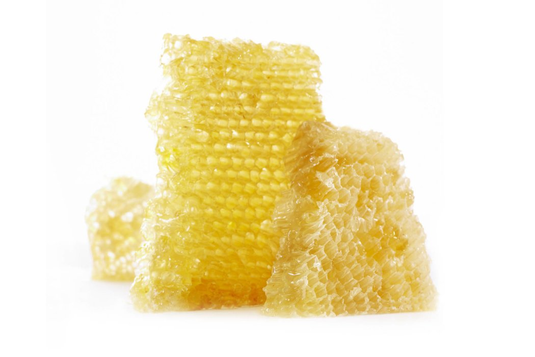Raw honey comb on white background