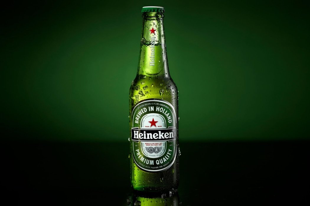 Heineken beer bottle on a green background